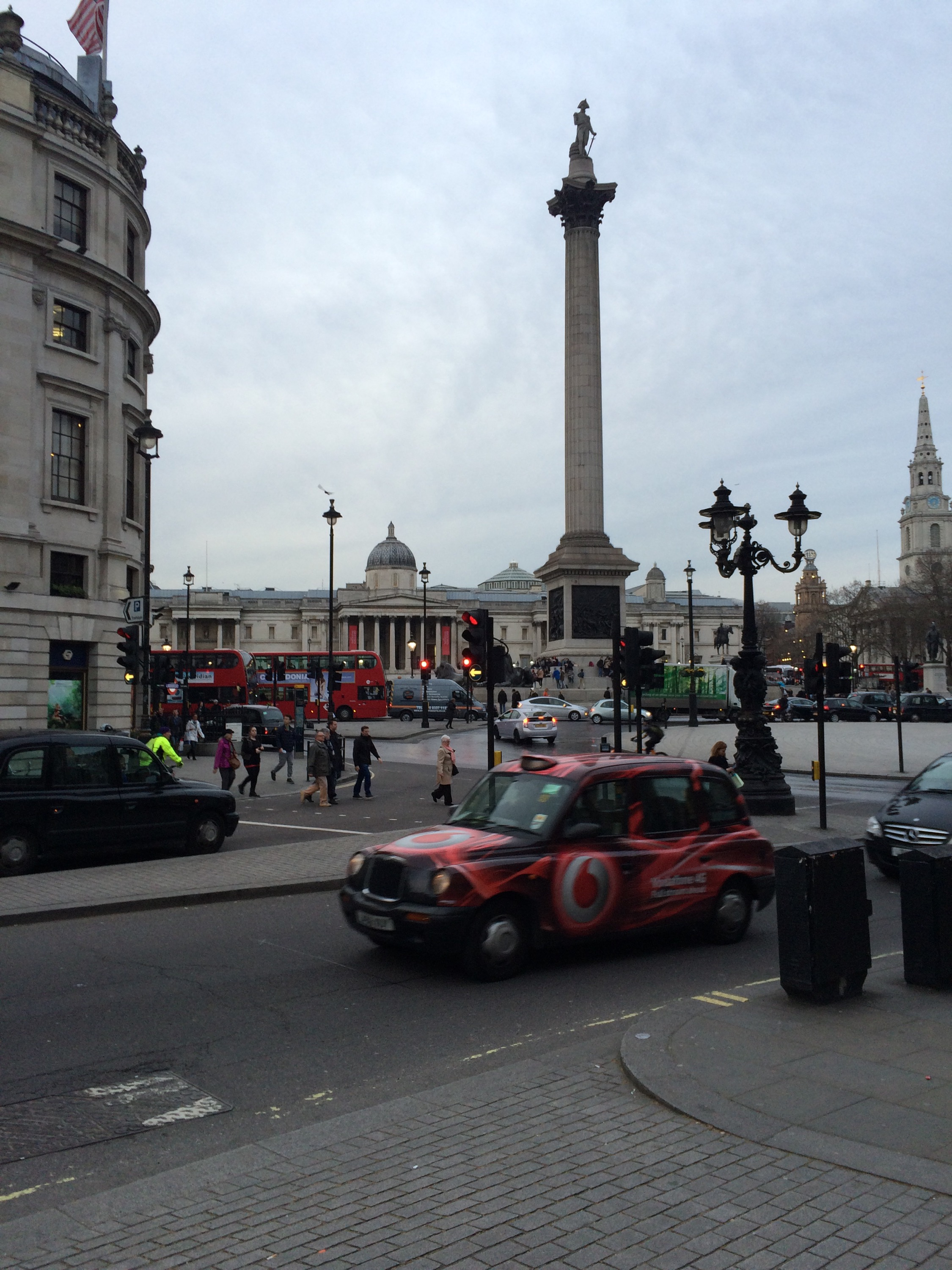 London, Trafalgar Square, black taxi, double decker bus